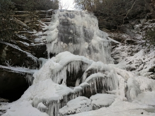 icicles and snow flow over the edge of the waterfall of the Blue Ridge Parkway